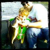 Father and Son with a Laremouth Bass