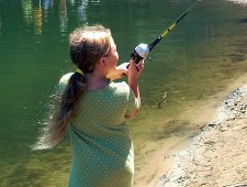 girl casting a spincast fishing reel freshwater