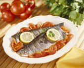 plated steamed trout fish with lemon