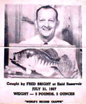 Fred Bright photgraphed with a replica mount of his record crappie.