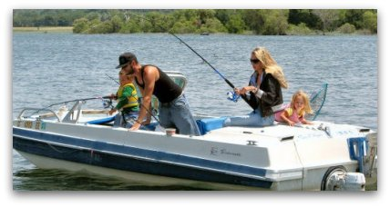 family fishing on a boat, beginners catching fish, freshwater fishing