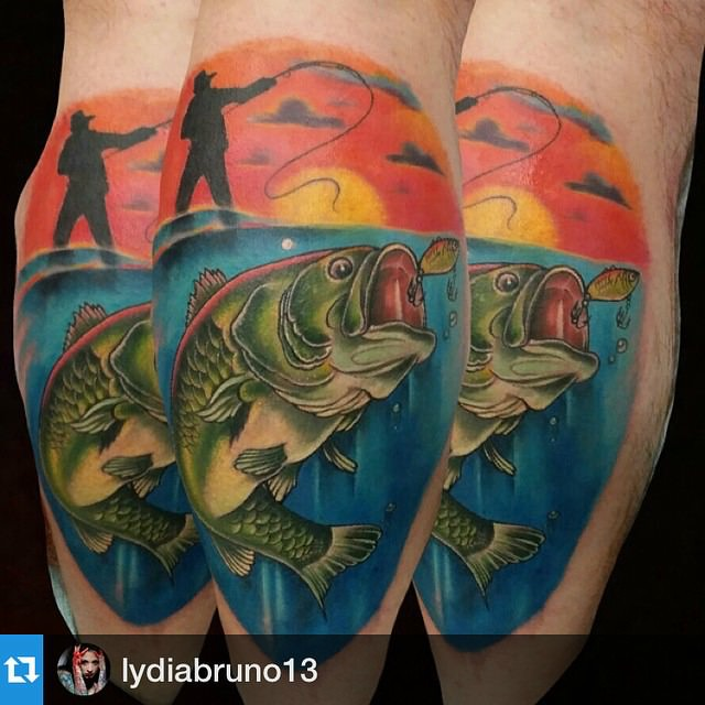 Tattoo of a largemouth bass attacking a fishing lure in the sunset.