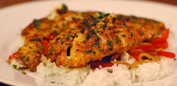 Cajun catfish over rice and bell peppers