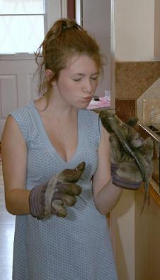Girl kissing a catfish.