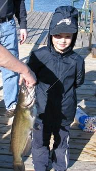 Boy with a catfish.