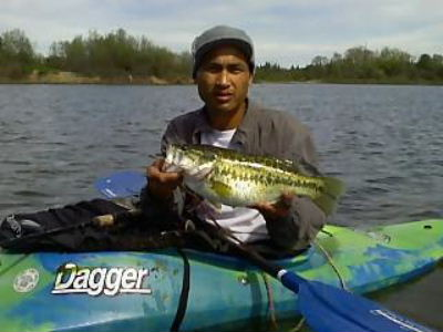 Catching largemouth bass from a Dagger Kayak