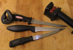 Variety of fillet knives and blade sharpeners.