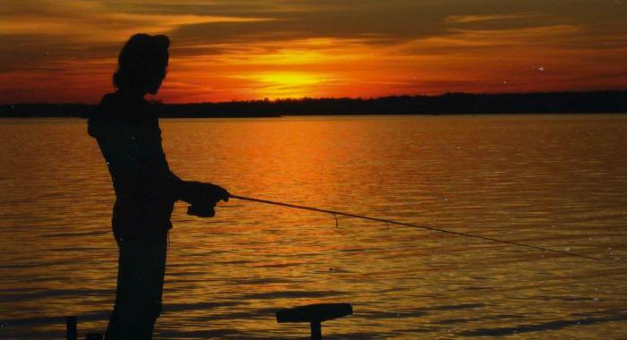 fishing addict fanatic at sunset