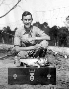 George Perry in 1934 with a big prized largemouth bass fish