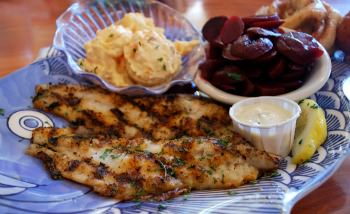 grilled catfish fillets lemon wedge fish plate