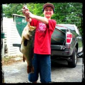 Kid with His Big Largemouth Bass