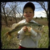 Little Kid with his Big Largemouth Bass