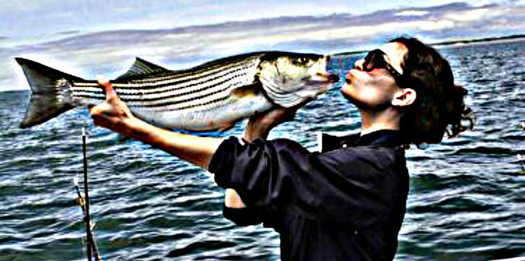 Woman Kissing A Striped Bass. photo credit by cmeleskiiii. edited by Jason at fishingloft.com