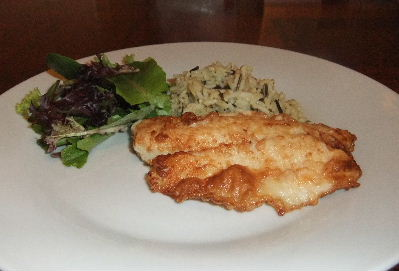 Plated Pan Fried Tilapia Fillet with Rice and Gorganzola Salad