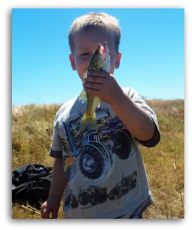 pond fishing boy with largemouth black bass