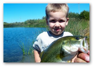 pond fishing kid with largemouth black bass