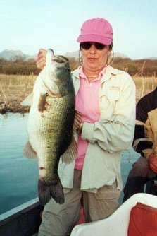 big largemouth bass caught by older woman
