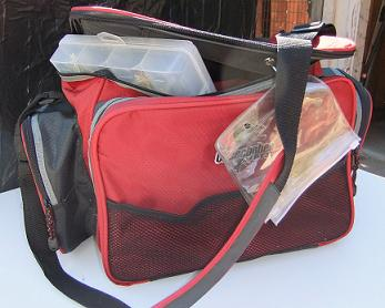 Red Colored Okeechobee Fishing Tackle Bag With An Adjustable Shoulder Strap.