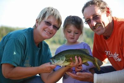 Addison and Grandparents with her Largemouth Bass