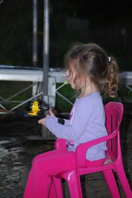 Addison Fishing and Eating a Popsicle