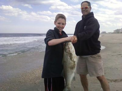 Ben and Uncle Joe with a New Jersey Striped Bass