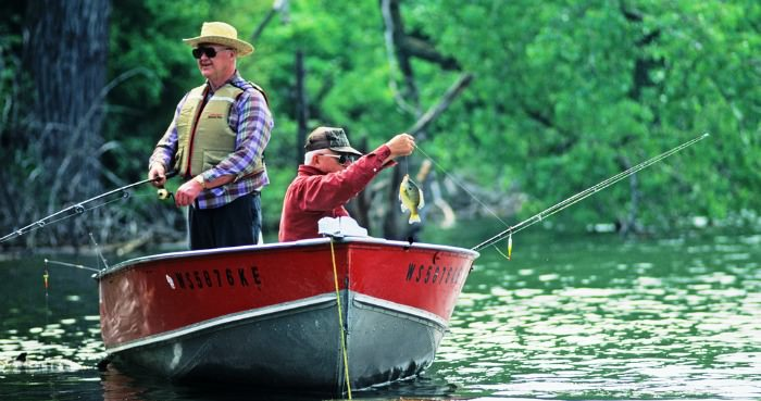 Bluegill fishermen on a boat - photo credit WDNR