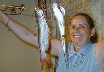 Woman With Catfish And Bass On Stringer