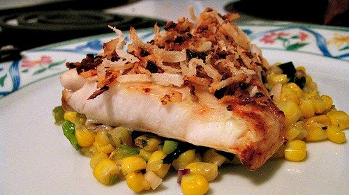 Coconut topped fish fillet with corn salsa
