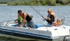 A Family Freshwater Fishing On A Boat