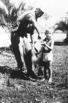 Jack Page holding George Perry's world record largemouth bass fish