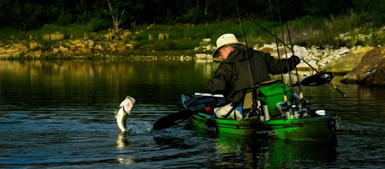 Catching Bass In A Kayak - photo credit by Michael Whitacre