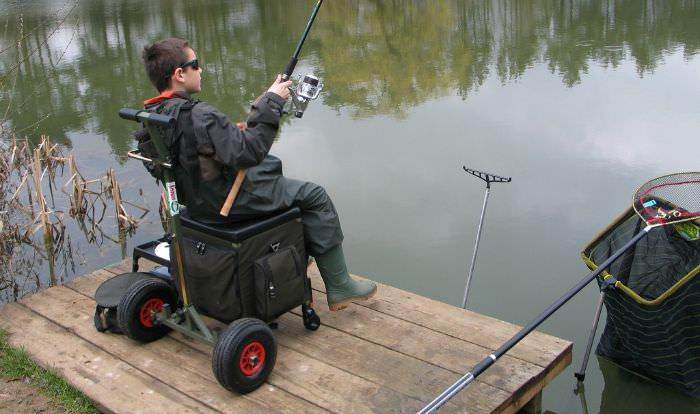 Large tackle box on big wheels with a handle.
