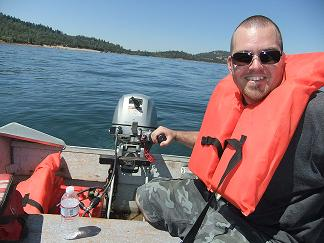 Jeremy wearing his perscription polarized sunglasses while freshwater fishing on the boat.