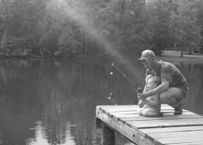 My Daughter Catching Her First Fish With Daddy