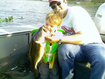 Hunter and Dad with a Pine Lake Largemouth Bass