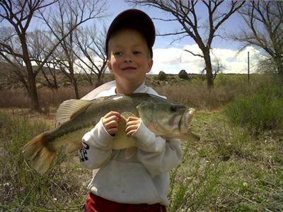 Little boy with his big largemouth bass.