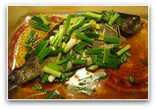 microwaved steamed trout fish with green onions and ginger