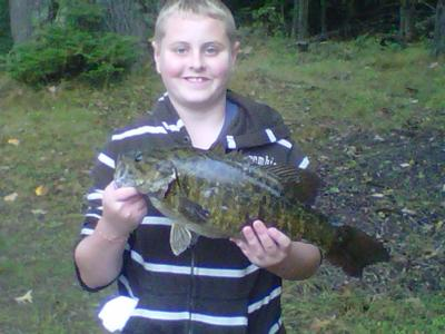 Out does his dad. Very proud - Wisconsin Smallmouth Bass