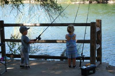 Grayson and Slade learning how to fish at Lake Cachuma